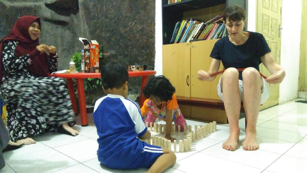 Volunteer and Children at the center
