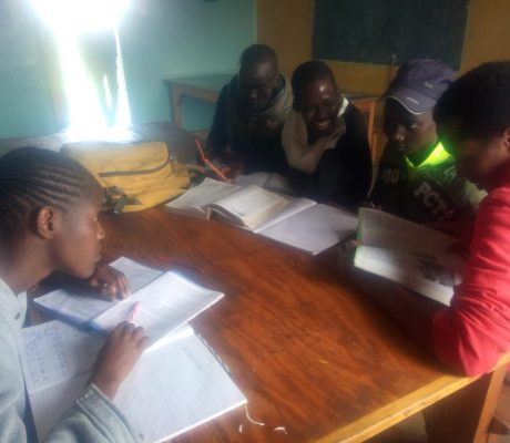 Children studying at the IHF family house after school